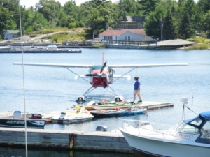 Float Plane arrives at Henry's