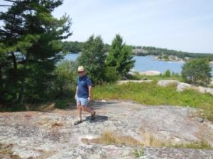 Mark climbing on rocks