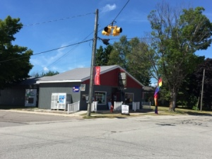 Outfitters store and lone traffic light