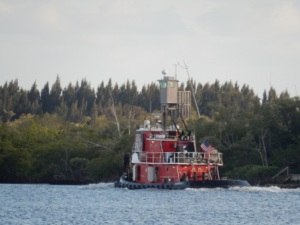 Passing tug at Peck Lake