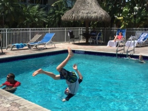 Daniel flipping into the pool