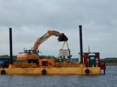 Repairing warning signs on ICW near St. Johns River