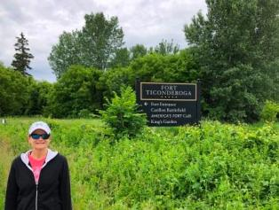 Denise at sign for Fort Ticonderoga