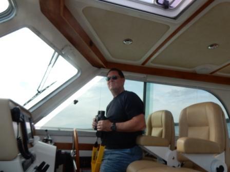 Captain Mark steering us along