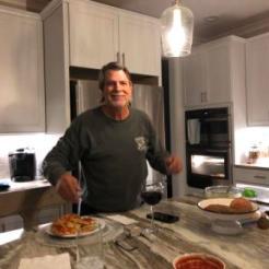 John serving up pizza