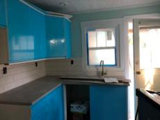 Kitchen - plastic protects white cabinets